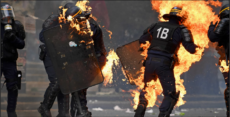 Antifa terrorists set police officers on fire in Paris