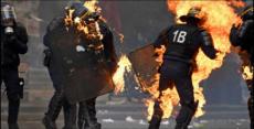 Antifa terrorists set police officers on fire in Paris